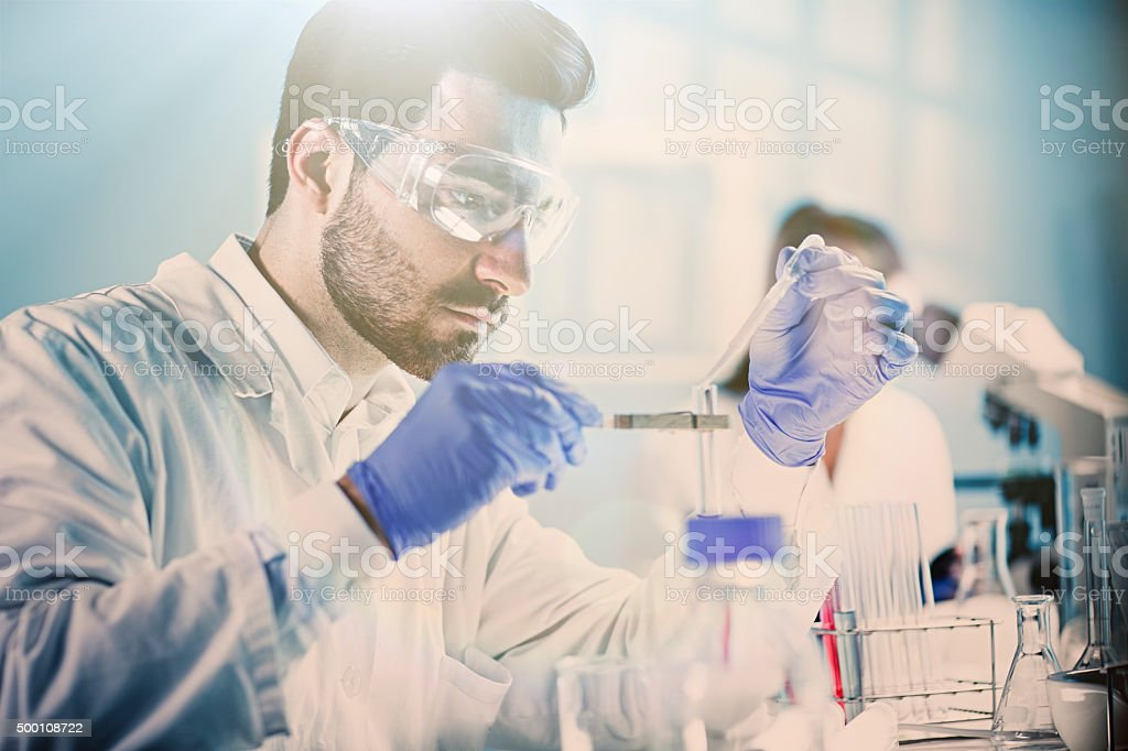 Lab Technician Holding Test Tube stock photo