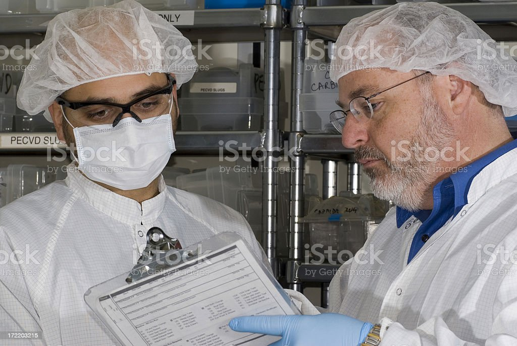 Lab Technicians with Clipboard stock photo