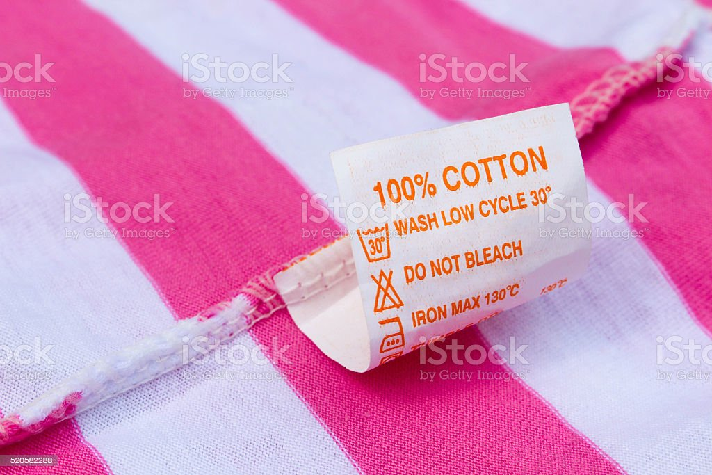 Label 100% cotton on pink and white t-shirt stock photo