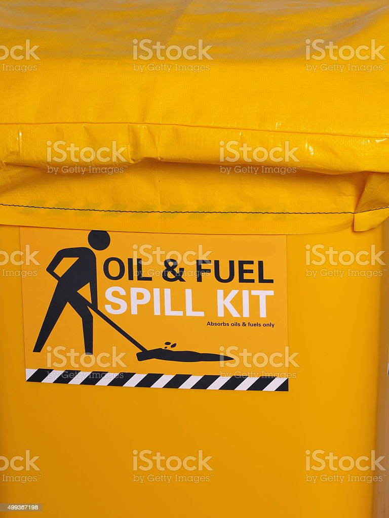 Labeled bright yellow industrial emergency spill kit stock photo