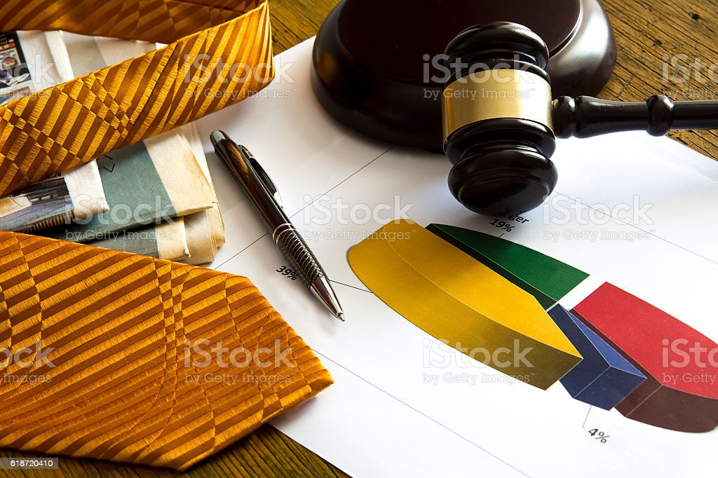 Labor law concept. Gavel, graphic, tie and newspaper stock photo