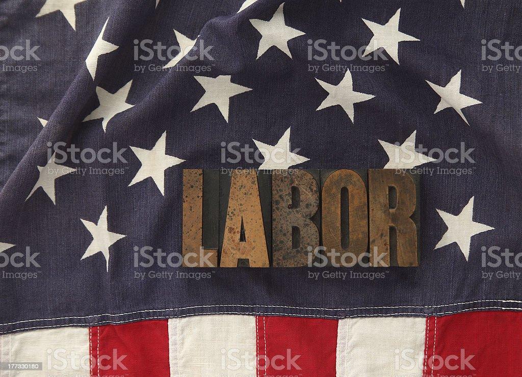 labor word on American flag stock photo