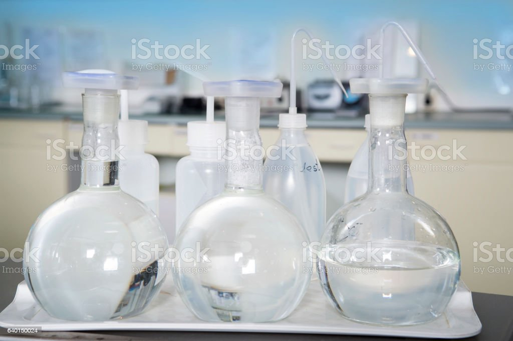Laboratory equipment, glass flasks in laboratory interior. stock photo