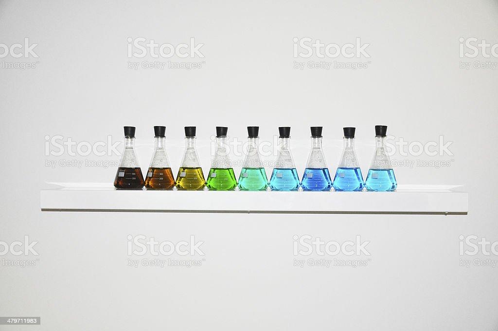 Laboratory equipment with liquid colors stock photo