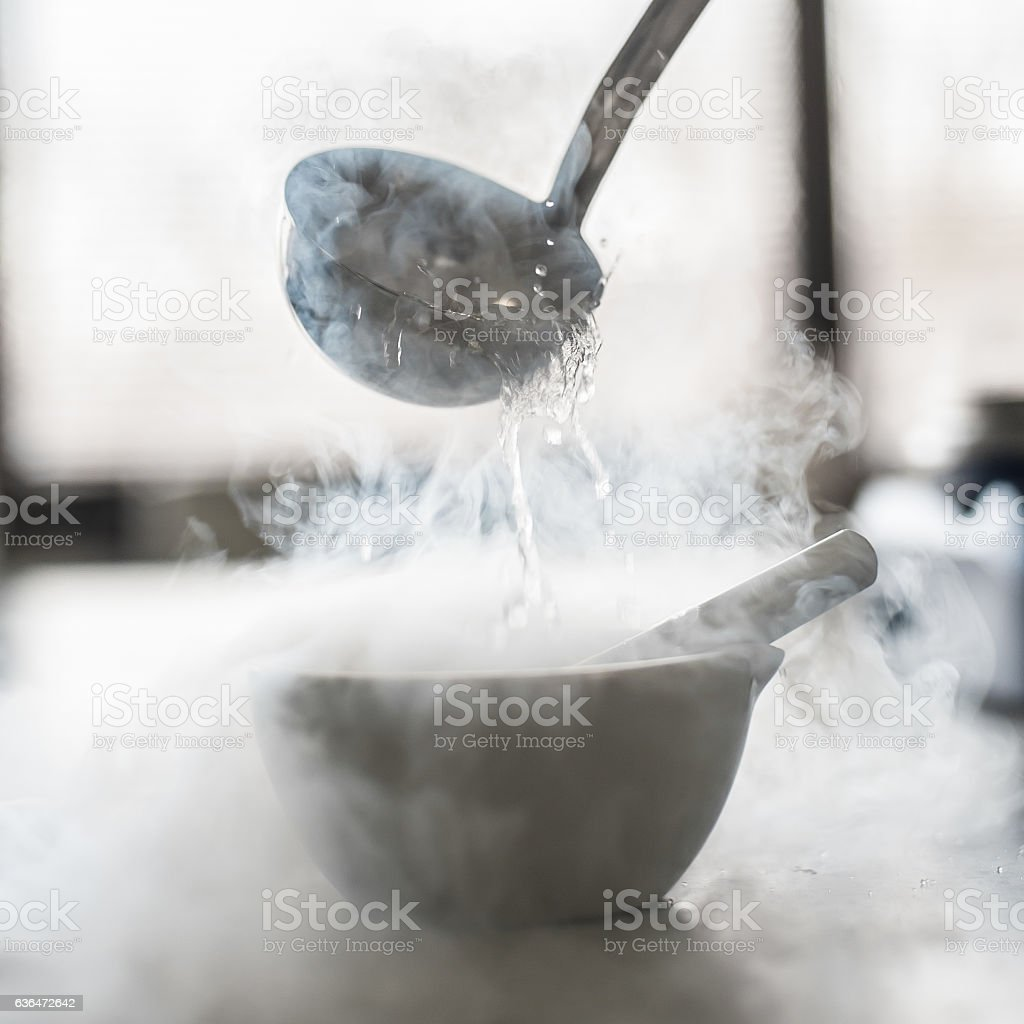 Laboratory experiment with liquid nitrogen in laboratory mortar stock photo