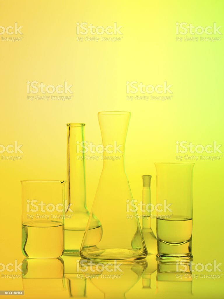 laboratory glass recipients on yellow background stock photo
