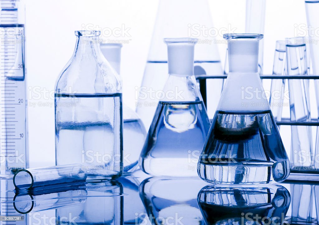 Laboratory glasses filled with various test fluids stock photo