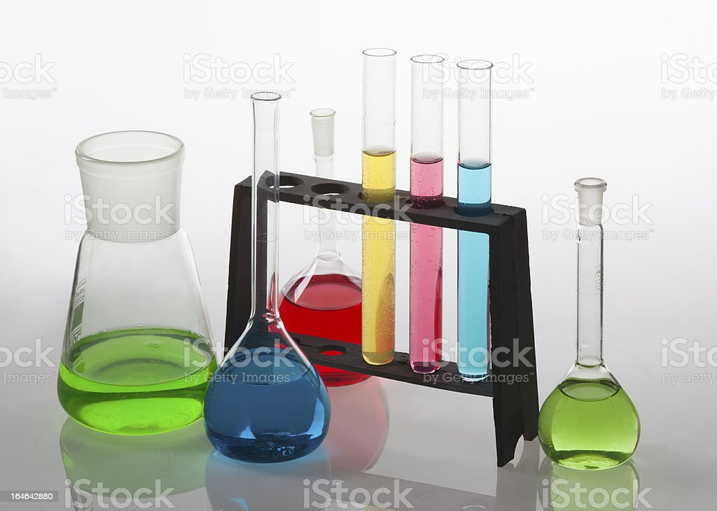 Laboratory glassware filled with various coloured liquids. royalty-free stock photo