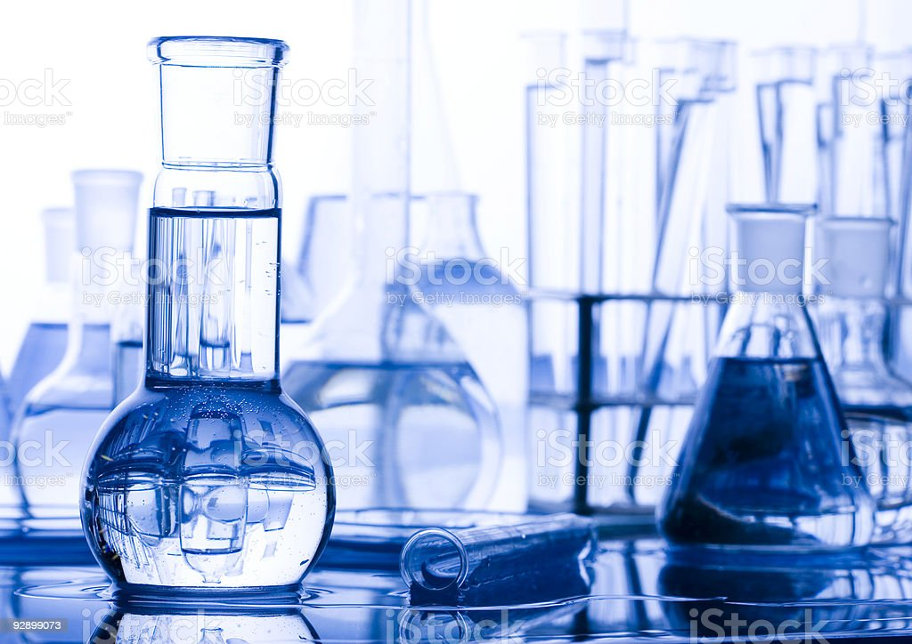 Laboratory glassware in blue tones stock photo