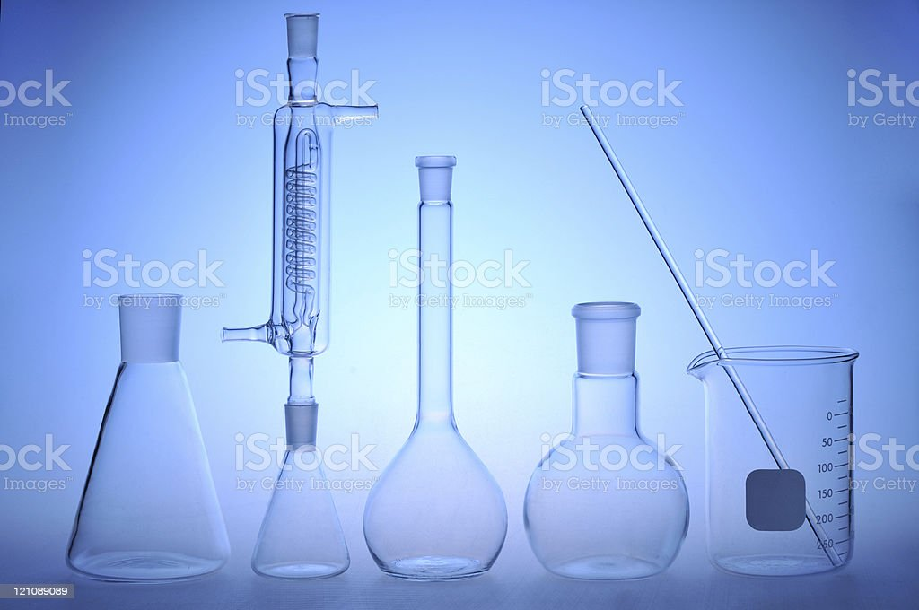 Laboratory glassware on a blue background royalty-free stock photo