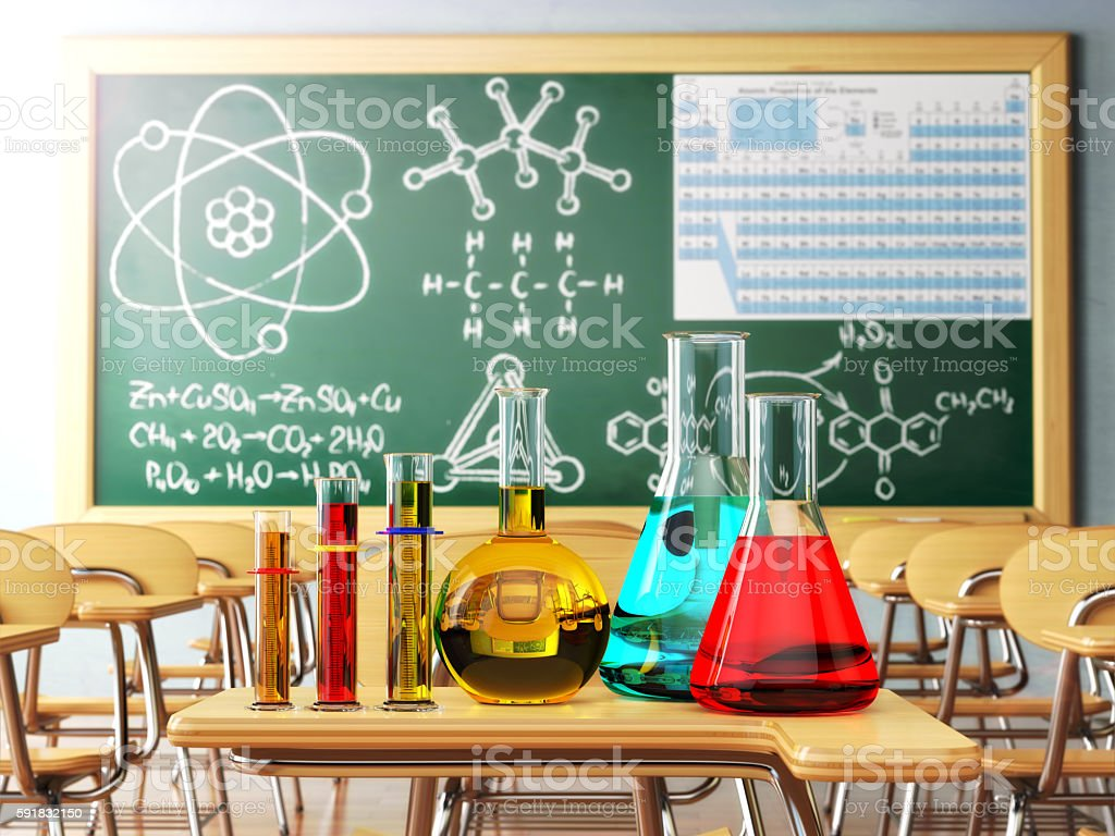 Laboratory glassware with formula on blackdesk in the school che stock photo