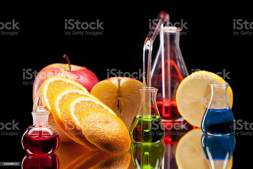 Laboratory glassware with fruits stock photo