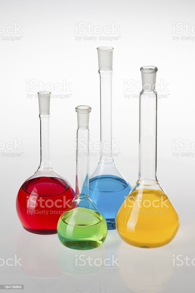 Laboratory glassware with liquids of different colors royalty-free stock photo