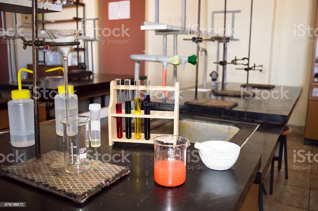 Laboratory Glassware with Red Liquid Ready for Filtration stock photo