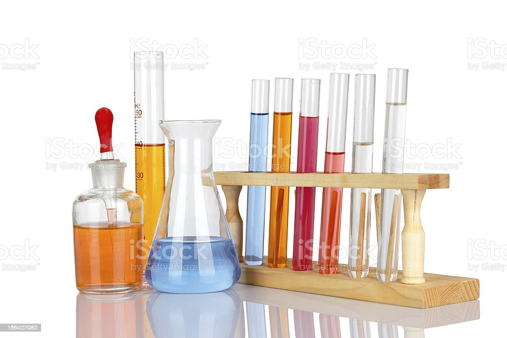 Laboratory glassware with reflections over white background royalty-free stock photo
