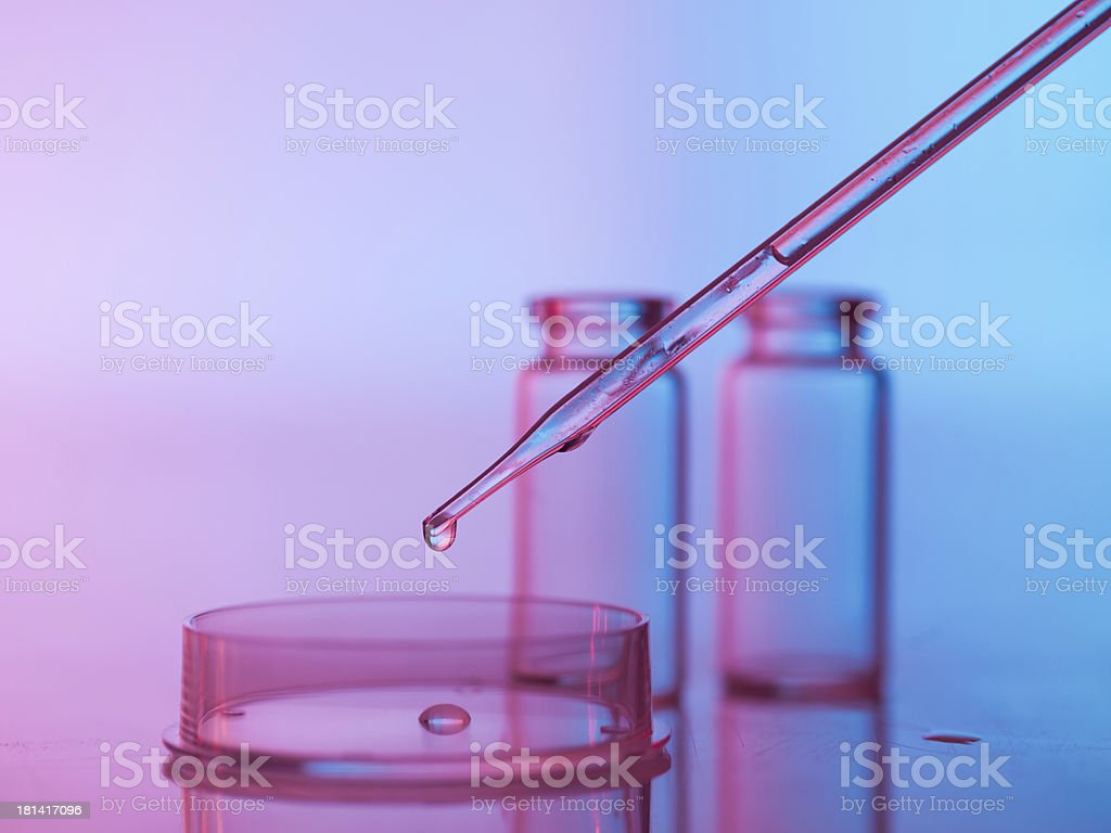laboratory glassware with tranparent liquid in pipette royalty-free stock photo