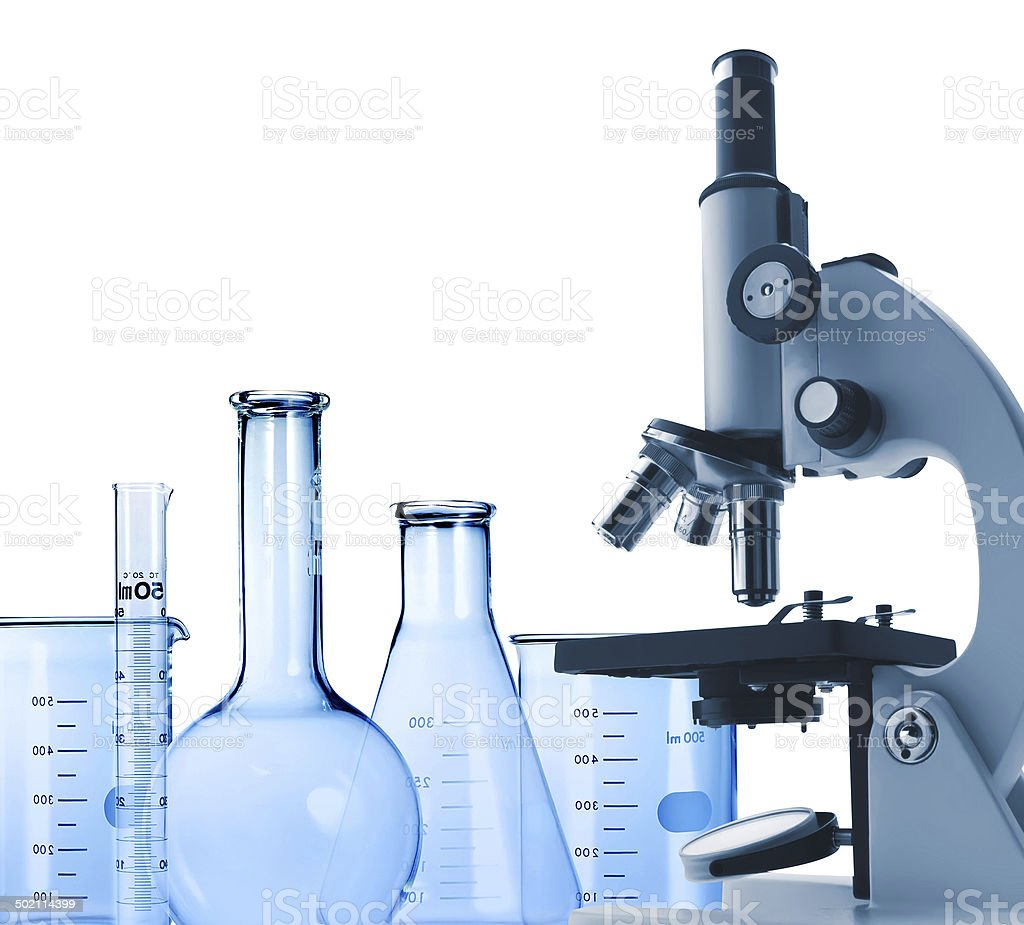 Laboratory metal microscope and test-tubes isolated on white royalty-free stock photo