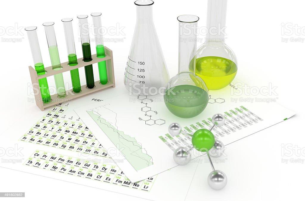 Laboratory Objects and green Liquids stock photo