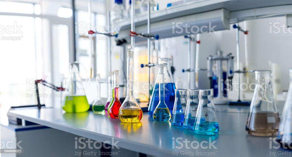 Laboratory table piled tubes with colored liquid stock photo