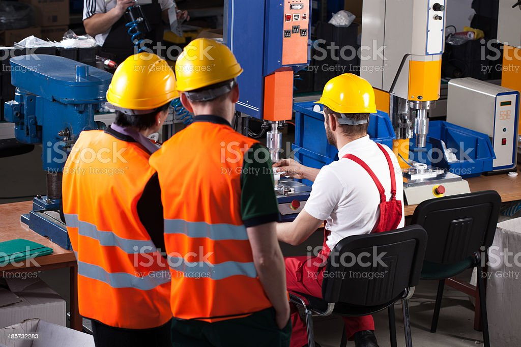 Labourers in factory stock photo