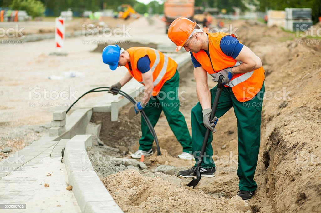 Labourers on a road construction stock photo