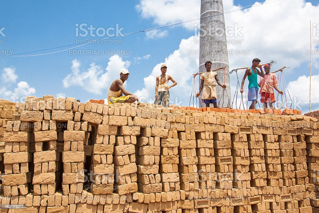 Labourers working in a Brick Kiln stock photo