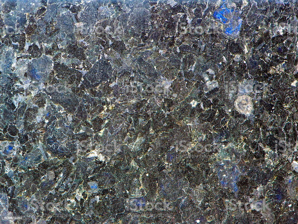 Labradorite mineral background (blue and yellow typical stock photo