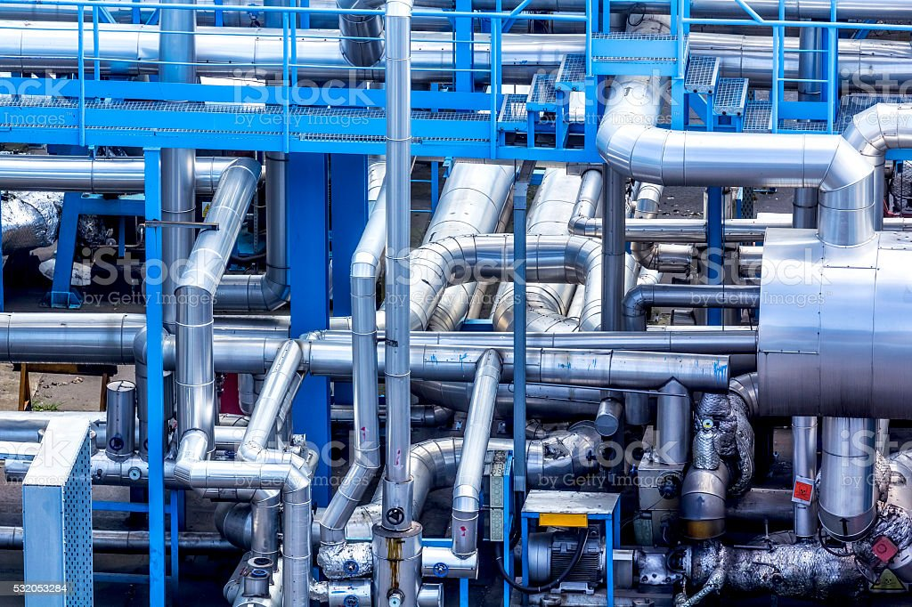 Labyrinth of of steel pipes in the refinery stock photo