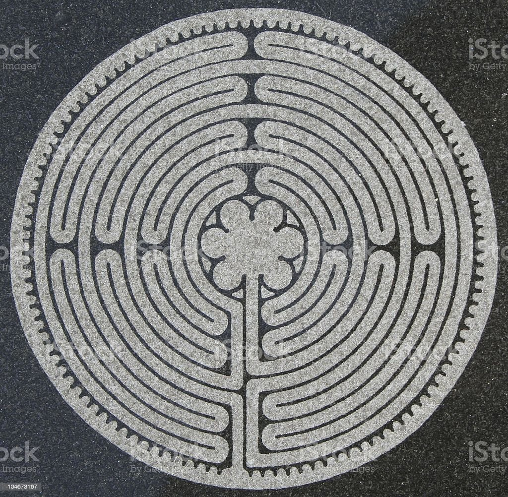 Labyrinth on marble stock photo