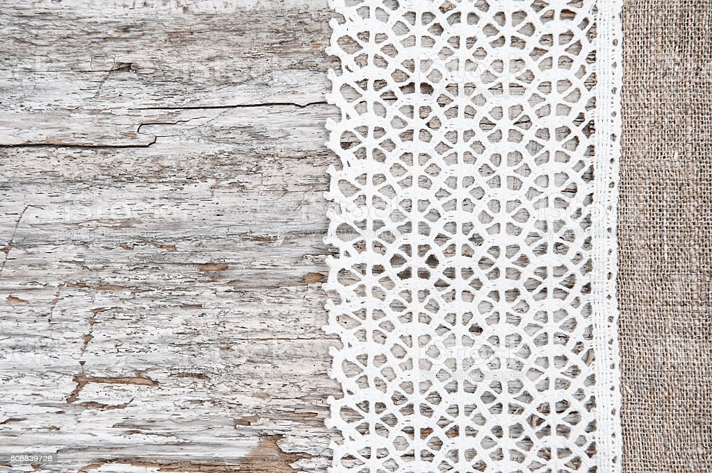 Lace fabric on the old wood stock photo