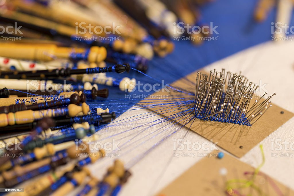 Lace Making with Wooden Bobbins stock photo