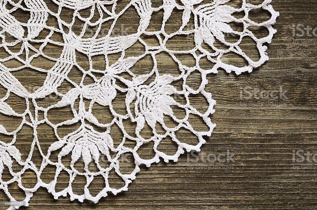 Lace on wood stock photo