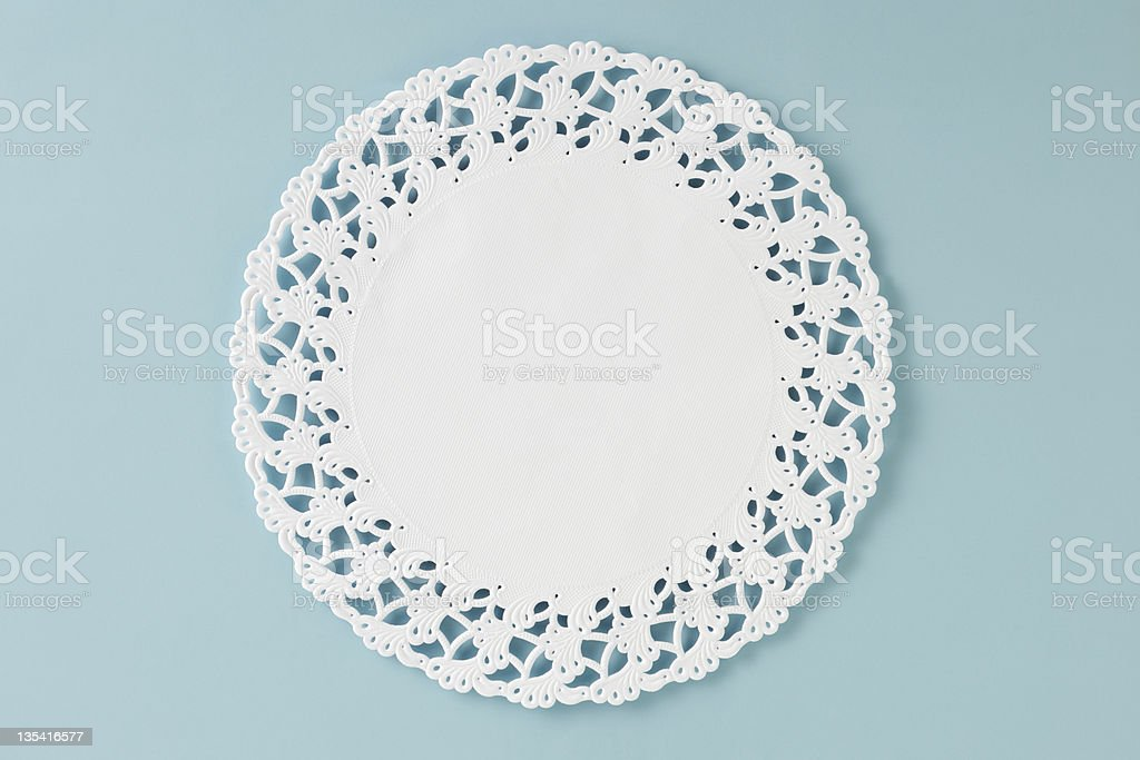 Lace paper doily stock photo