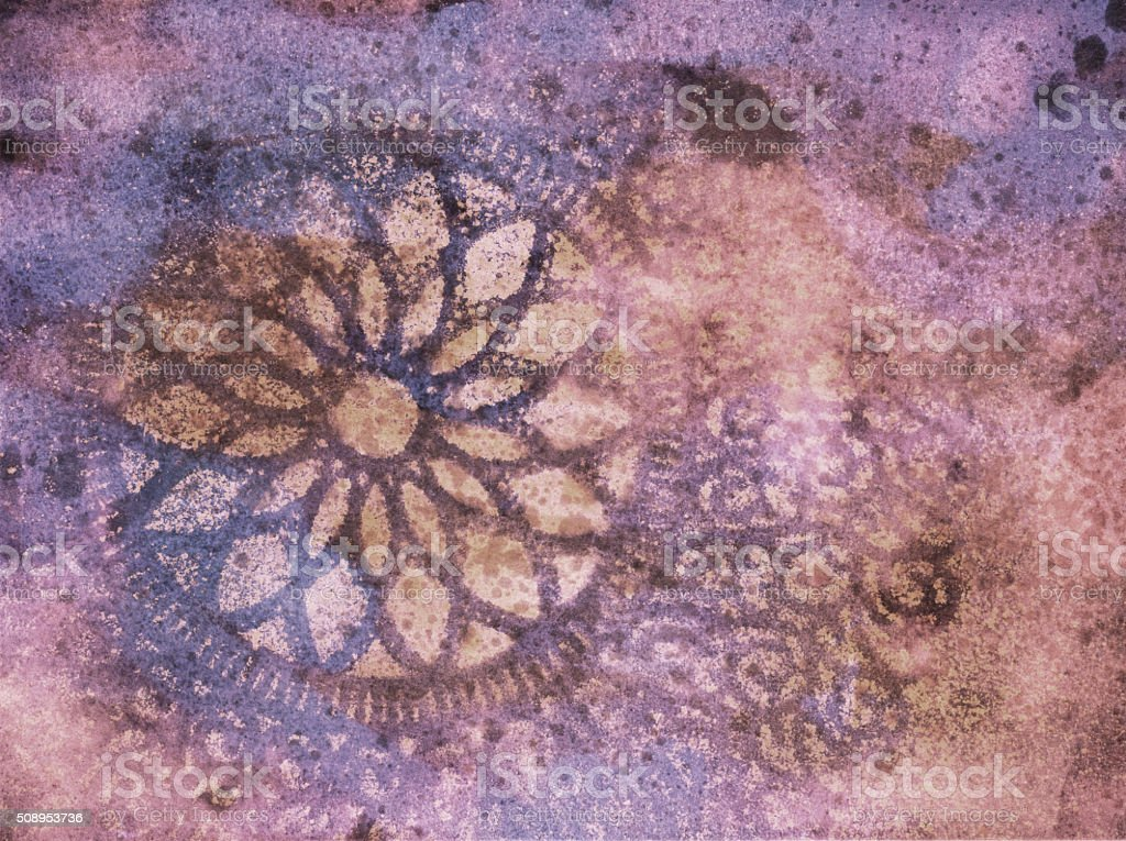 Lace pattern layered over multiple colors of paint and texture stock photo