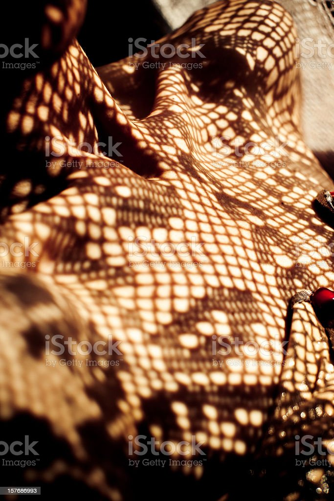Lace shadow on woman's chest stock photo