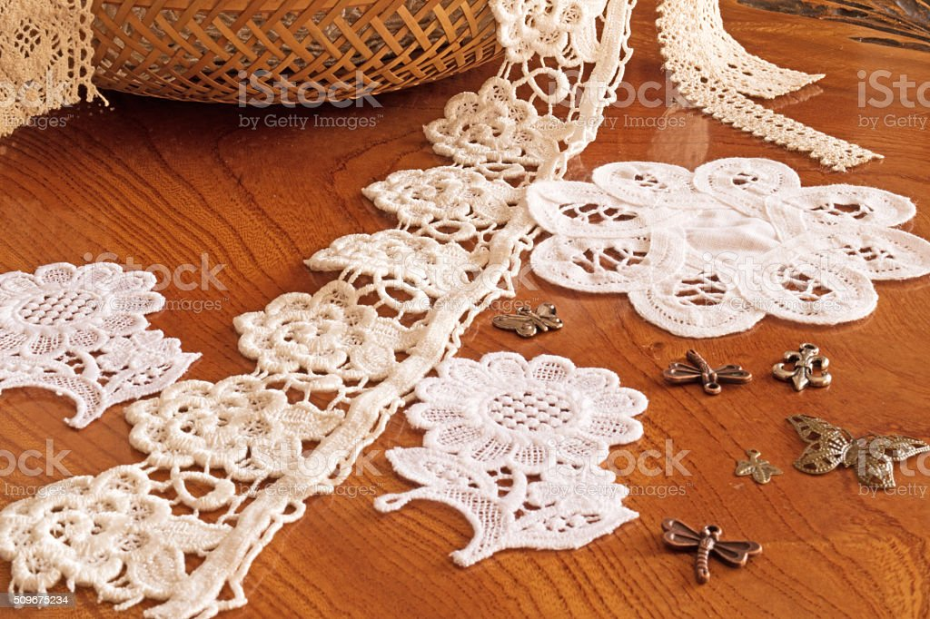 lace tape in a wicker basket on the table. stock photo
