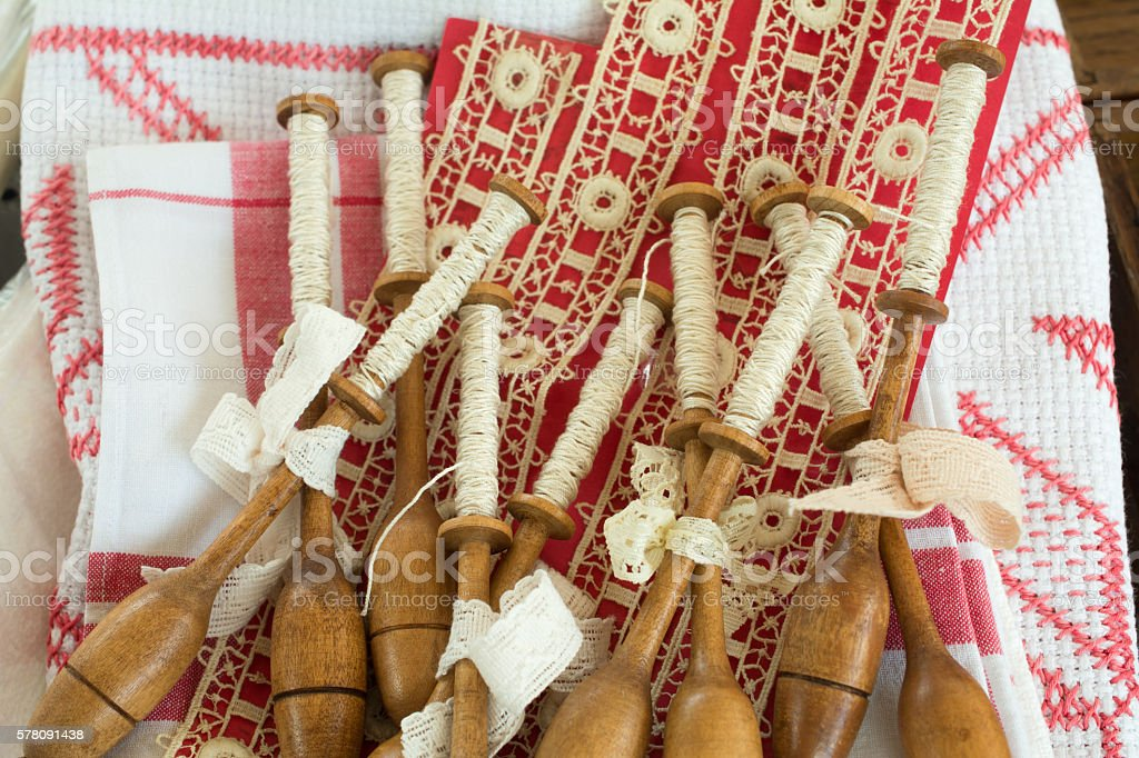 Lacemaking spools on a flea market stock photo