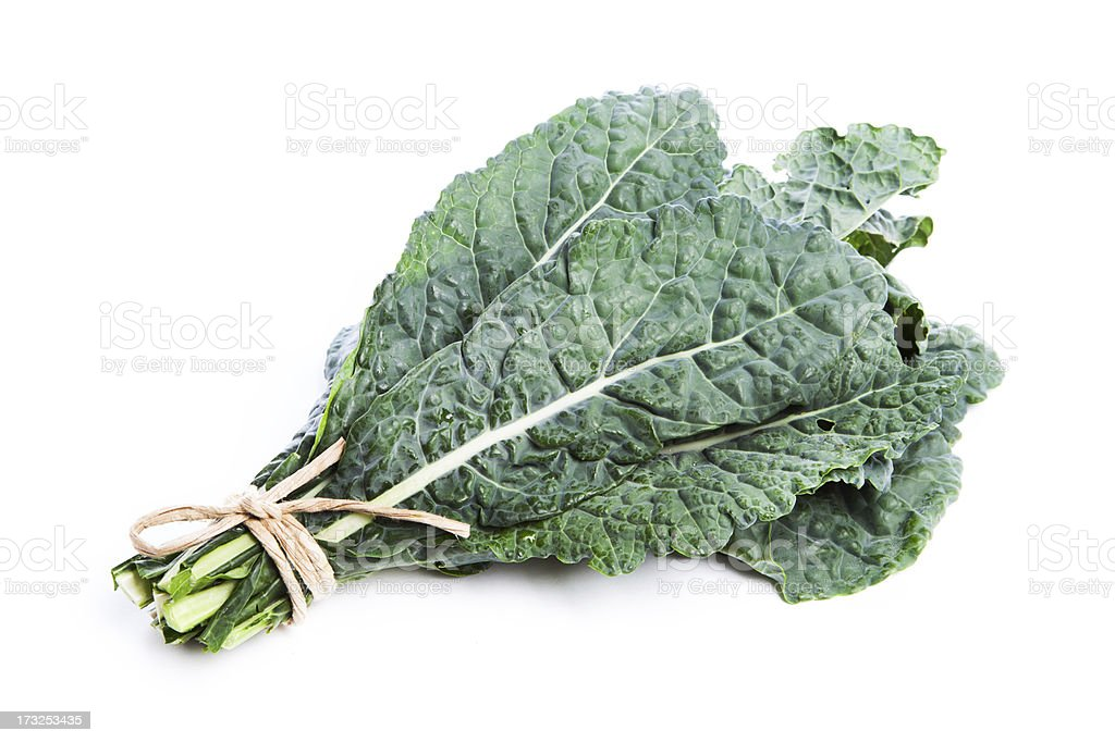 Lacinato Kale, Raw Green Vegetable Tied Bunch, Isolated on White royalty-free stock photo