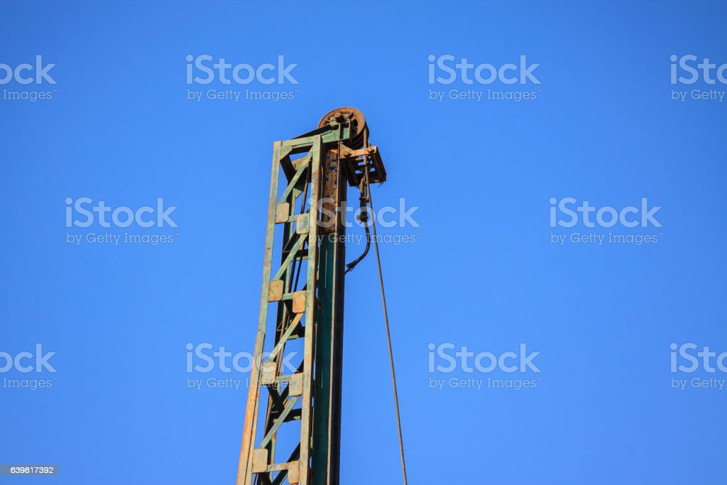 Lack of crane hook, construction crane and blue sky stock photo