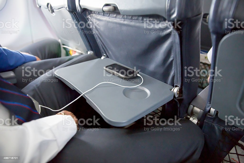 Lack of legroom in the middle seat on airplane stock photo