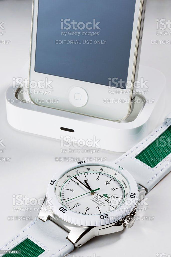 Lacoste Wristwatch & Apple iPhone stock photo