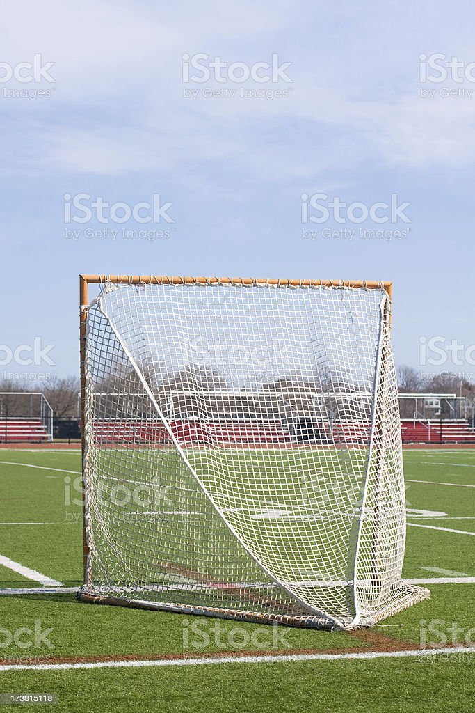 Lacrosse goal posts and net on football field stock photo
