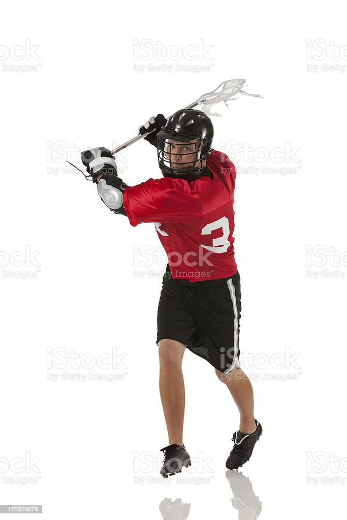 Lacrosse player in action stock photo