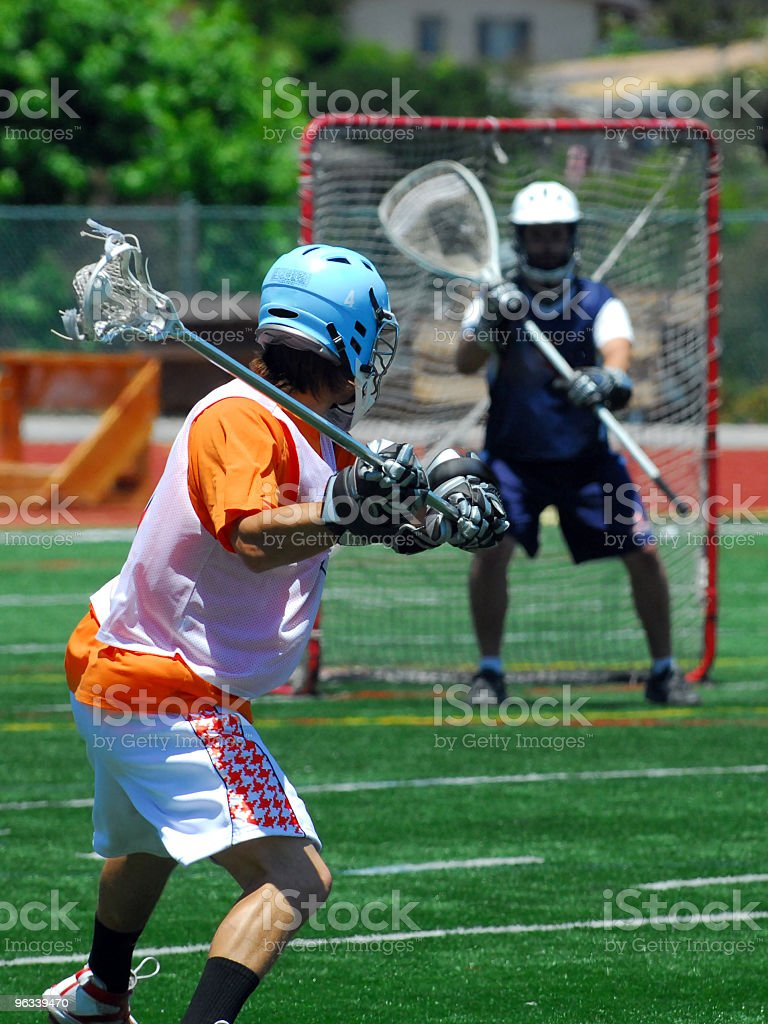 Lacrosse shooter aiming for goal royalty-free stock photo