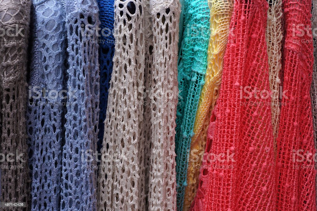 Lacy pullovers on hangers. stock photo