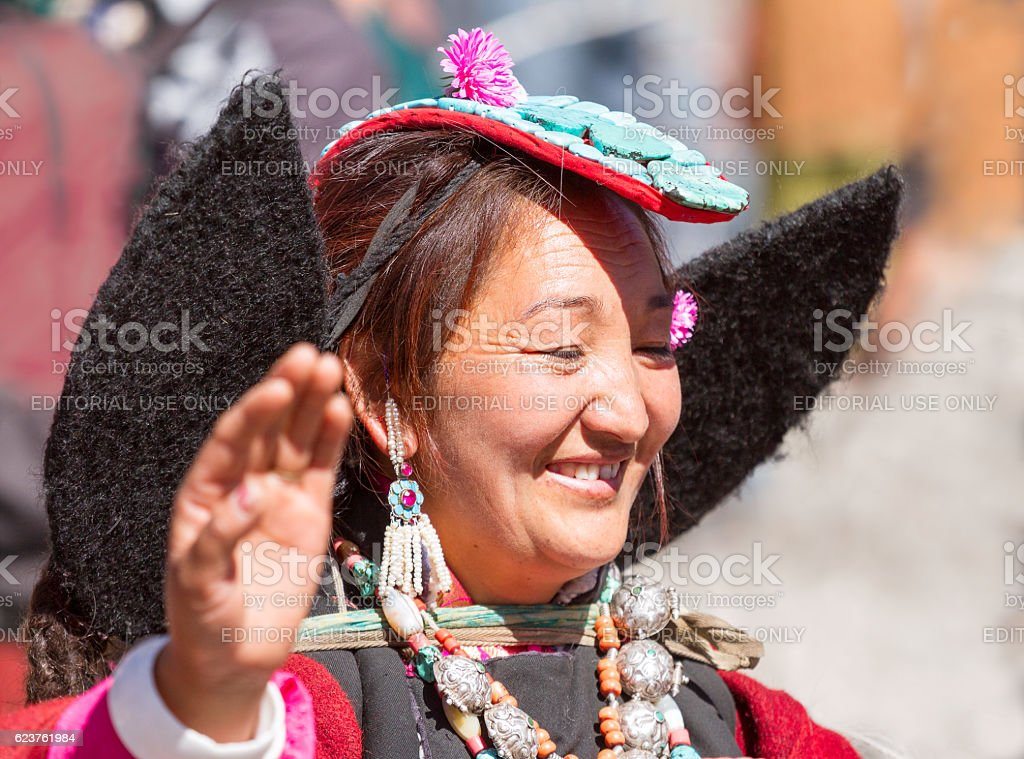 Ladakhi tribal woman in traditional clothing with headgear 'Peark' stock photo