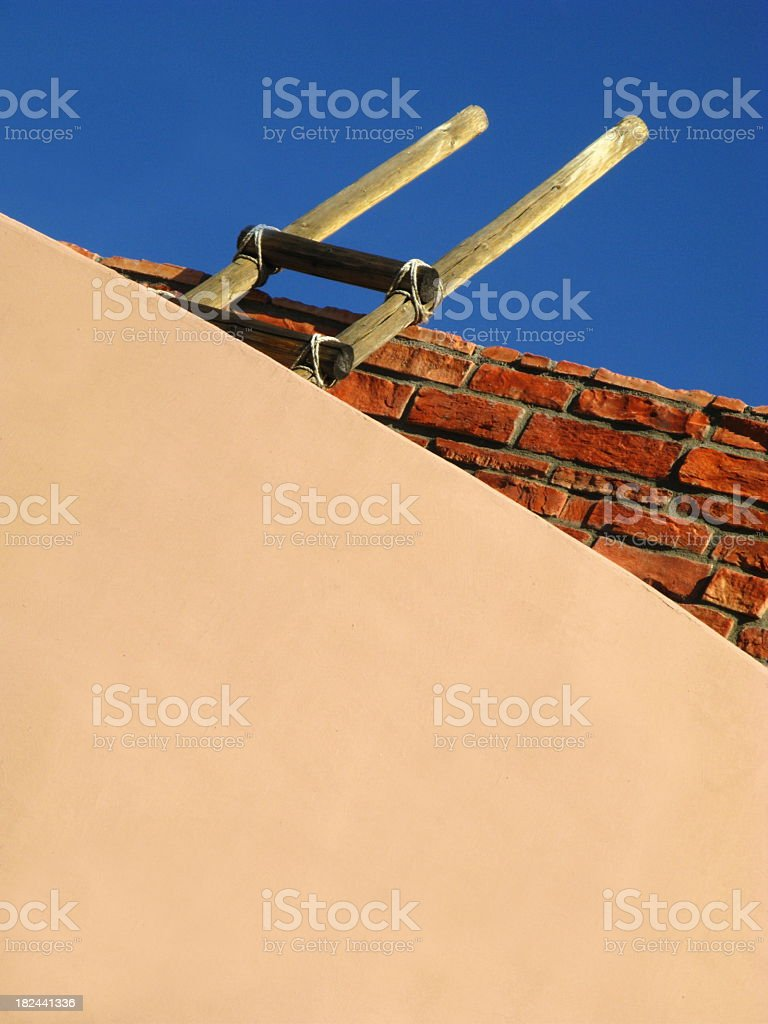 Ladder Adobe House stock photo