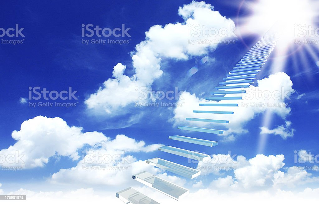 ladder directed up to blue cloudy skies and sun royalty-free stock photo