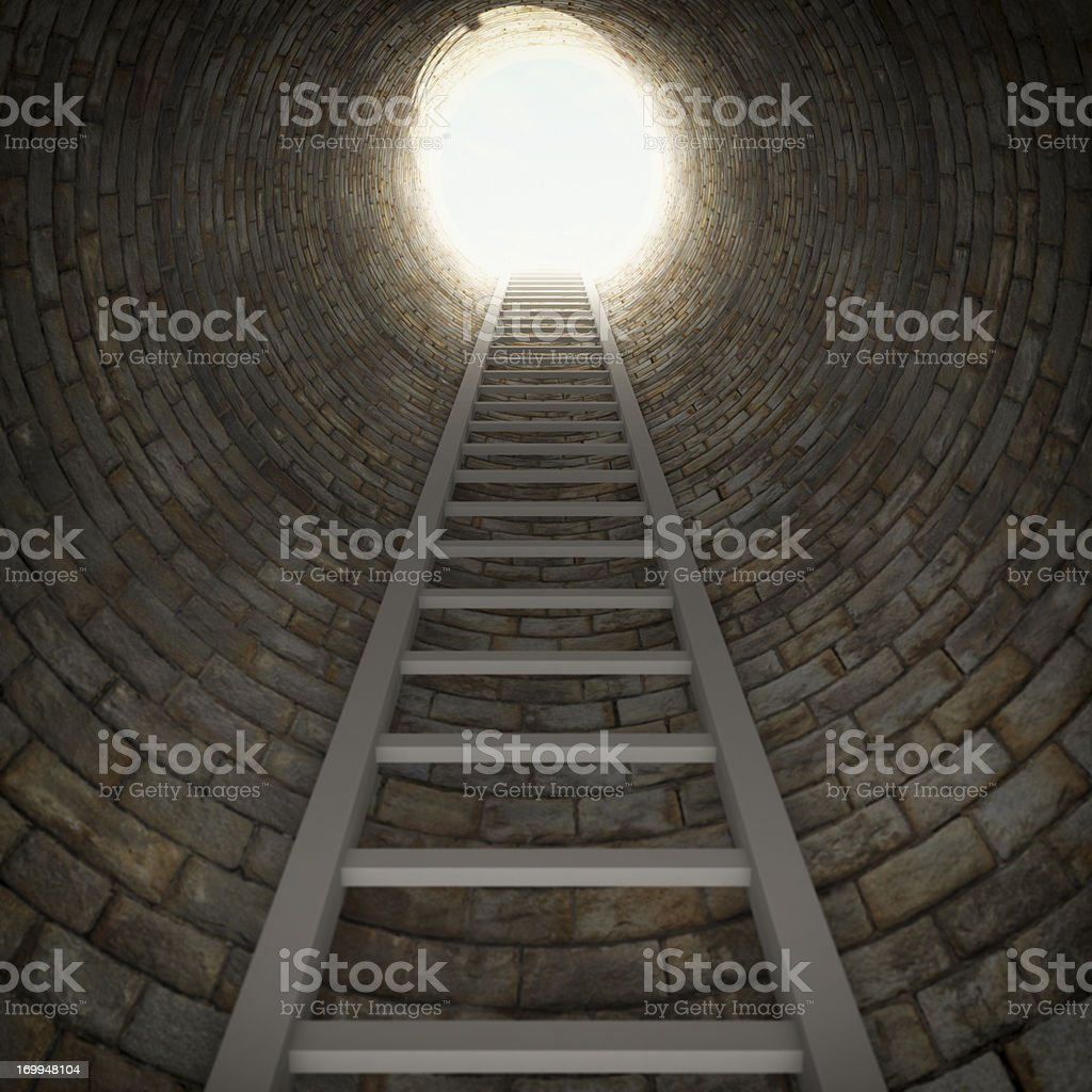 Ladder In A Dark Well stock photo
