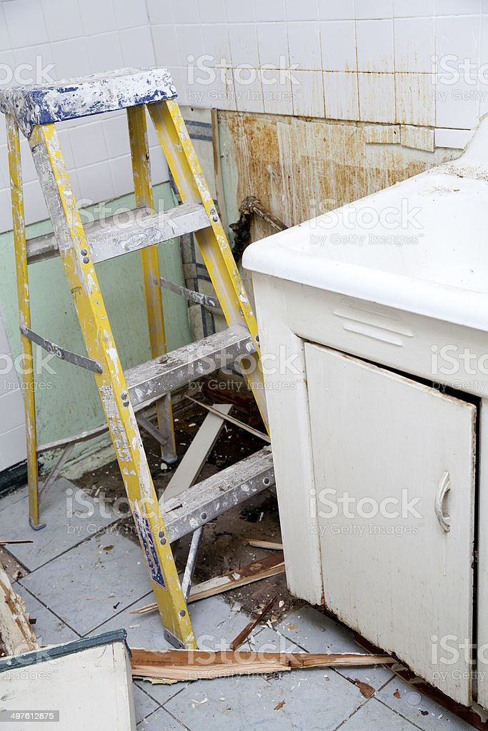 Ladder in messy renovated kitchen stock photo